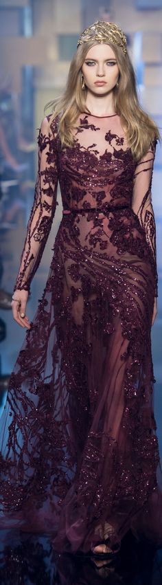 The beading on this gown is stunning. The sheer fabric in a deep reddish-purple is so sexy.