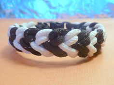 What a great idea...Paracord Survival Bracelet Black Reflective and Glow in the Dark. $10.00, via Etsy.