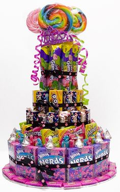 5 tier candy cake doubles as decor and favors... (hand out empty bags and let the kids fix their own treat bags).