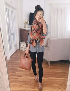 black leggings, a grey shirt, brown suede lace up flats