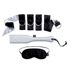 Explore your Christian Grey and Anastasia Steele fantasies with the official Fifty Shades of Grey bedroom bondage gift set. 4 bondage restraints, a blindfold and a spanking paddle are included to take your erotic awakening from the page to the bedroom.