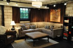 Industrial basement remodel with curtains.