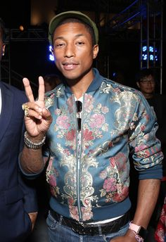 Pharrell Williams. Still hot. (We wouldn't mind borrowing his floral bomber jacket, either) <3