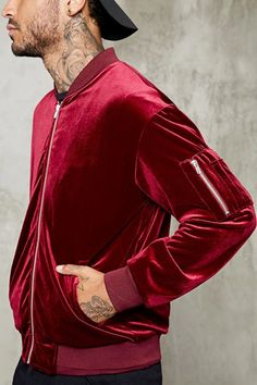 Style Deals - A velour bomber jacket featuring a zippered front, ribbed knit trim, a zippered utility pocket on one of the long sleeves, slanted front welt pockets, and an interior chest patch pocket.