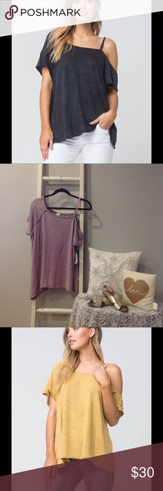 NWT Free People Cold Shoulder Distressed Tee Super cute and comfy! This one is a distressed light purple color. Casual and cute! Free People Tops