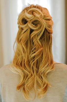 25 Gorgeous Half-Up, Half-Down Hairstyles.  Rosette Half Up    Pretty spirals reminiscent of flowers make this romantic half updo super special.  Get the tutorial on Sidewalk Ready.