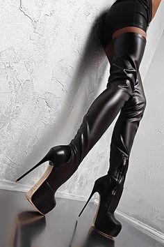 Black leather miniskirt and thigh boots