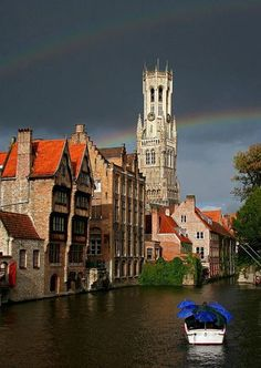 Rainbow above the belfry in Bruges, Belgium  Photo by jjcordier
