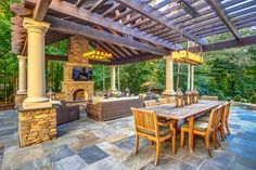 HGTV presents a lovely stone patio with spa and an expansive koi pond with waterfall. The space also includes an oudoor dining room and a living room with stone fireplace.