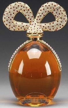 Antique Perfume Bottle with a Crystal Encrusted Bow for the Bottle's Top<3<3Very Decadent<3<3