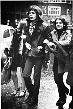 Mick Jagger walking with a young girl on each arm.  Dear girls, don't get your hopes up too high...you see, there's this guitar player...  :)) Just kiddin'...sort of.