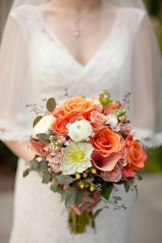 Lovely Bridal Bouquet: Peach Calla Lilies, Peach Stock, Peach Roses, Orange Roses, White Dahlias, White Ranunculus, White Hypericum + Green Eucalyptus