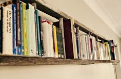 Not a wooden pallet, but an old wooden ladder, functioning as a Bookshelf. Fits well to the wooden pallets recycling ideas...