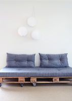 Shabby chic and rustic charm are everywhere these days; and one of the most noticeable aspects of these themes are reclaimed wood accents. Wood shipping pallets are a cheap and easy ways to add that rustic chic charm. So here are our 15 favorite uses for wood pallets + tips and tricks for finding and disassembling them from We Lived Happily Ever After.  The above  wooden palette was photographed by Stephanie Michelle. You can see the entire feature here