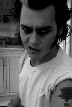 Jonny Depp as Sweeney Todd with an Elvis twist/// Haha!   Oh I loved him in sweeny todd
