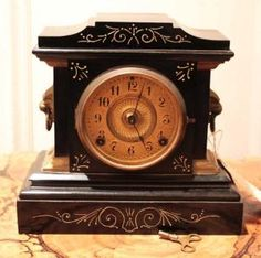 Black is such a great color!!  Ansonia mantel clock from 1890s