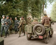 General Montgomery passes German POWs while being driven in a jeep along a road in Normandy, 8th of June 1944.