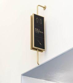 El Gallinero diseña la señalética de Axel Hotel Madrid Hotel Signage, Shop Signage, Wayfinding Signage, Signage Design, Signage Board, Bathroom Signage, Navigation Design, Sign System, Environmental Graphic Design