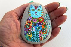 Hand Painted Stone Cat Beach pebble with hand-painted designs in acrylics © Sehnaz Bac 2015 I paint and draw all of my original designs by hand with the small brushes or paint pens with extra fine tip. I use also isographs with different inks. No stencils are used. All designs are created with my imagination. These pebbles were found on the beaches of Adriatic Sea. Each was chosen for its shape, smoothness and uniformity. They are protected with 2 or 3 layers of high quality glossy acrylic…