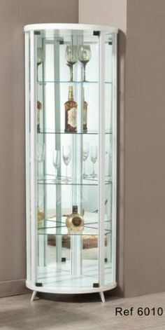 A Cristaleira de canto redonda é toda espelhada, refletindo a decoração e beleza do seu ambiente! Disponível em outros acabamentos. Medidas: 60 x 173 x  60 cm. http://www.moradamoveis.com/