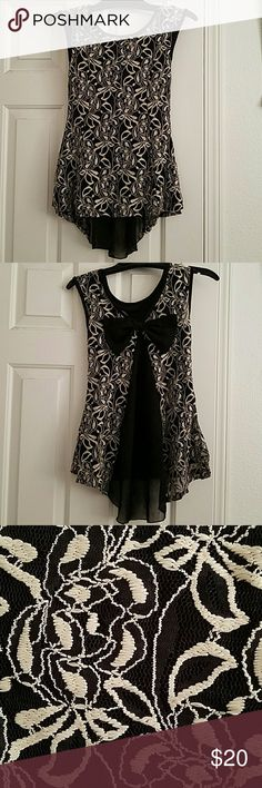 Black and Cream Lacey Blouse Sweet black/cream blouse with bow in back. Asymmetrical hem, longer in back. Easily dressed up or dressed down! Julie's Closet Tops Blouses