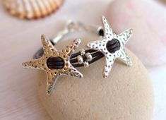 Excited to share the latest addition to my #etsy shop: Leather Jewelry, Stars Bracelet, Black Leather Silver Bracelet, Starfish Bracelets, Cuff Bangle, Leather Bangle, Leather,Silver Starfish http://etsy.me/2CMJTSG #jewelry #bracelet #silver #beachtropical #black #wome