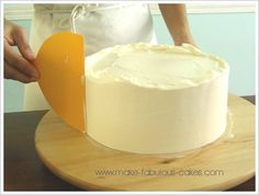 smoothing the sides of a cake