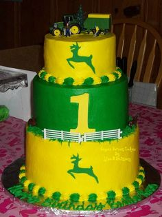 "John Deere 1st Birthday for Twins - This cake was ordered with a 3 tiered strawberry shortcake cake for twin boy & girl's 1st birthday. 2 layer 6"", 3 layer 8"", & 3 layer 10"". Buttercream frosting. TFL!"
