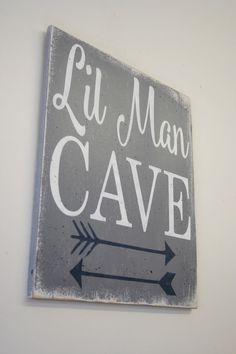 This item ships FREE! Lil Man Cave! This is a wood sign that measures 12 x 14. The background is painted Gray. Words are White and arrow design
