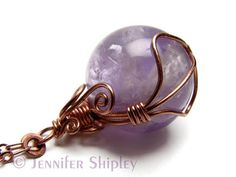 Handcrafted with a natural purple amethyst crystal sphere, pure copper wire and nickel free copper chain, this healing pendant necklace is a powerfully spiritual amulet for transformation. The amethyst crystal ball pendant is wire wrapped with nickel-free copper wire to a shiny