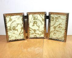 GOLD METAL FRAMES 5x7 Triple Ornate Picture Frame 3 Hinged Frames 1970s Retro Brass Frame by framecottage on Etsy https://www.etsy.com/listing/501300026/gold-metal-frames-5x7-triple-ornate