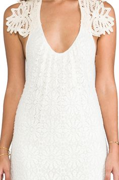 The lace details on this white dress are just to die for.