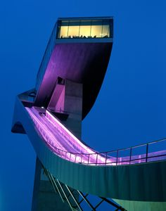 Dramatic nighttime lighting of the Bergisel Olympic ski jump. Architects: Zaha Hadid