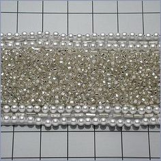 6 YARDS Silver Pearl and Crystal Beaded Trim for Sash or Headbands. $204.98, via Etsy.