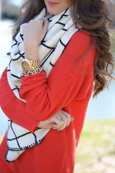 Fold a square scarf in half—corners to corners and place the ends around your neck for a bib-like look.