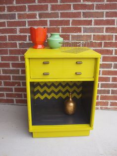 """""""This is a Drexel 1960s ALL SOLID WOOD Night Stand/ End Table that I hand painted in a vibrant yellow (it has a touch of green to it that is not portrayed well in the pictures ) and dark gray. I added a chevron pattern in the back of the bottom opening. I then hand distressed the whole piece to add character and interest."""""""