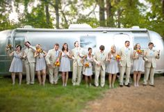 This looks very Jetsons-like!!!....wedding party doing the robot in front of an airstream trailer
