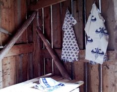Summer kitchen. Fishing farm. Blue-white towels. French lilies pattern