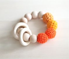 Orange, tangerine, pumpkin, deep carrot orange teething ring toy with crochet wooden beads. Rattle for baby... via Etsy shop, NiHaMa