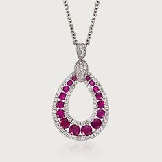 Gregg Ruth 1.23 Carat Total Weight Ruby and .57 Carat Total Weight Diamond Necklace in 18-Karat White Gold. Outlined by diamonds, rubies look dramatic in this teardrop design. By Gregg Ruth, this necklace captures attention in 18-karat white gold.