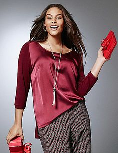 Fashion forward with a mixed-media motif, this trendy tee goes beyond basic with a satiny woven front and high-low hem. Made to flatter curves with bust darts and a charming scoop neckline, it's finished with 3/4 sleeves and a faux chest pocket. lanebryant.com
