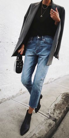 Andy Csinger + sleek and street ready + spring outfit + faded denim mom jeans + black Chelsea boots + black tee + marl grey blazer + minimal accessories + leather mini bag.  Jeans: Morrison Clothing.