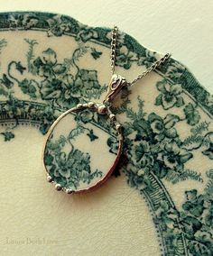 Broken china jewelry oval pendant necklace antique English transferware teal iris or violets