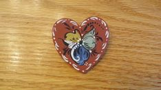 Measuring about 1 this adorable wooden heart pin is painted in a Norwegian style of rosemaling. Since each is hand-painted, it might Scandinavian Pattern, Scandinavian Folk Art, Rosemaling Pattern, Norwegian Style, Norwegian Christmas, Norwegian Rosemaling, Bird Houses Painted, Kraft Gift Boxes, Metal Pins