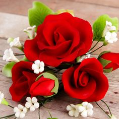 Trio Garden Rose Sprays in Red are gumpaste sugarflower cake decorations perfect as cake toppers for cake decorating fondant cakes and wedding cakes. Caljava wholesale cake supply.