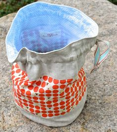 Using some cute Japanese polka-dot fabric, Kristie from Obsessive Crafting Disorder created this sweet flat-bottomed drawstring bag to give as a gift and took some