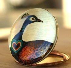 Jewelry - Vintage Locket. Did you know the peacock is an ancient symbol of the early Church? The peacock became a symbol of Christ and the Resurrection. Its image embellished everything from the Catacombs to everyday objects especially in early Romanesque and Byzantine churches.
