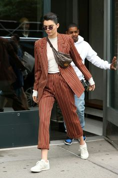 Kendall Jenner in striped suit, fanny pack and white sneakers