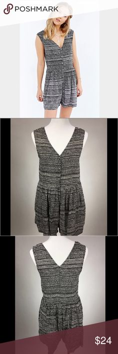 Urban Outfitters Ecote Romper This adorable sleeveless romper was purchased from Urban Outfitters and worn just a handful of times. The brand is Ecote - fun buttons on front add cute visual detail! Size Large - fits M/L. Urban Outfitters Pants Jumpsuits & Rompers
