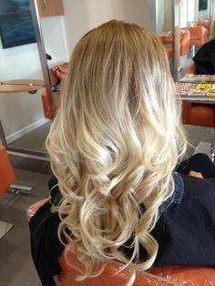 relaxing curls with blonde ombre hair